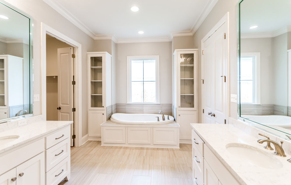 Large Soaking Tub in Master Bathroom flanked by Built Ins