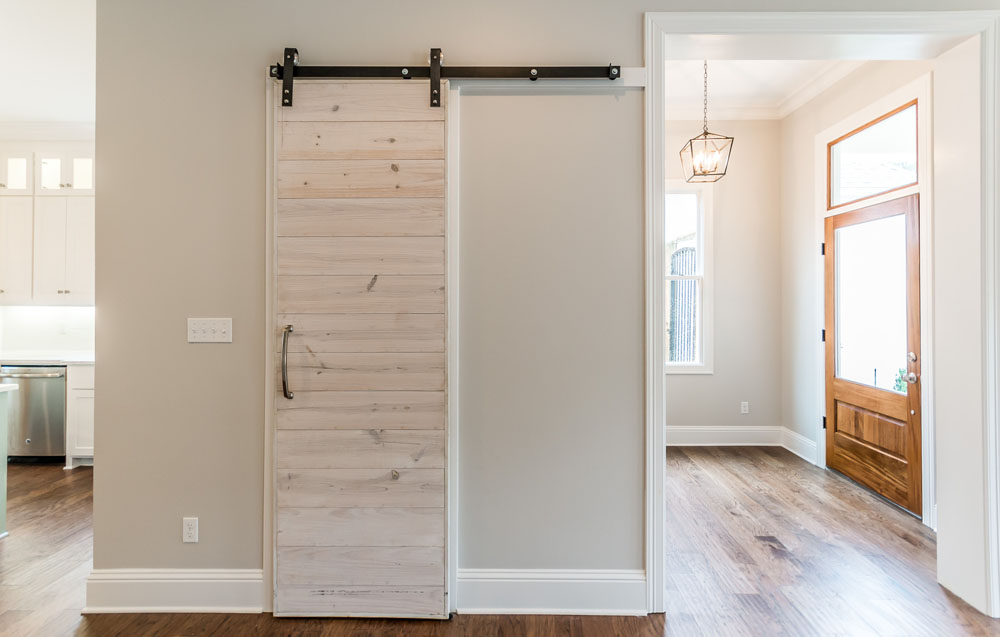 Whitewashed Sliding Barn Door Accent in New Home in Provenance