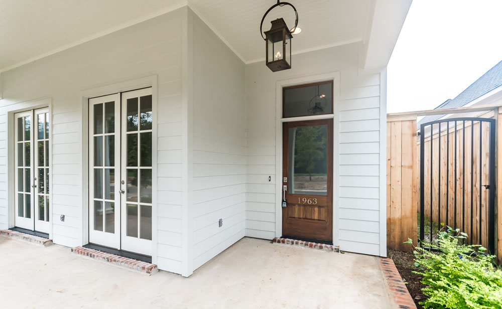 Wooden Front Door with Gas Lantern and Transom Windows